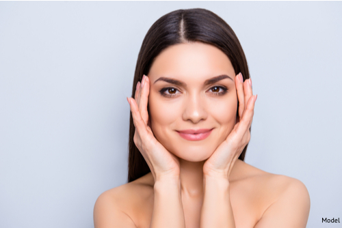 A woman enjoying her facelift results.