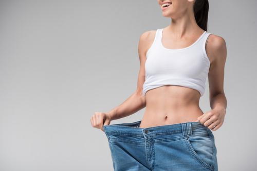joyful slim girl showing result of diet-img-blog