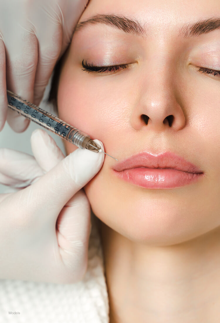 Woman getting injections above her lip line