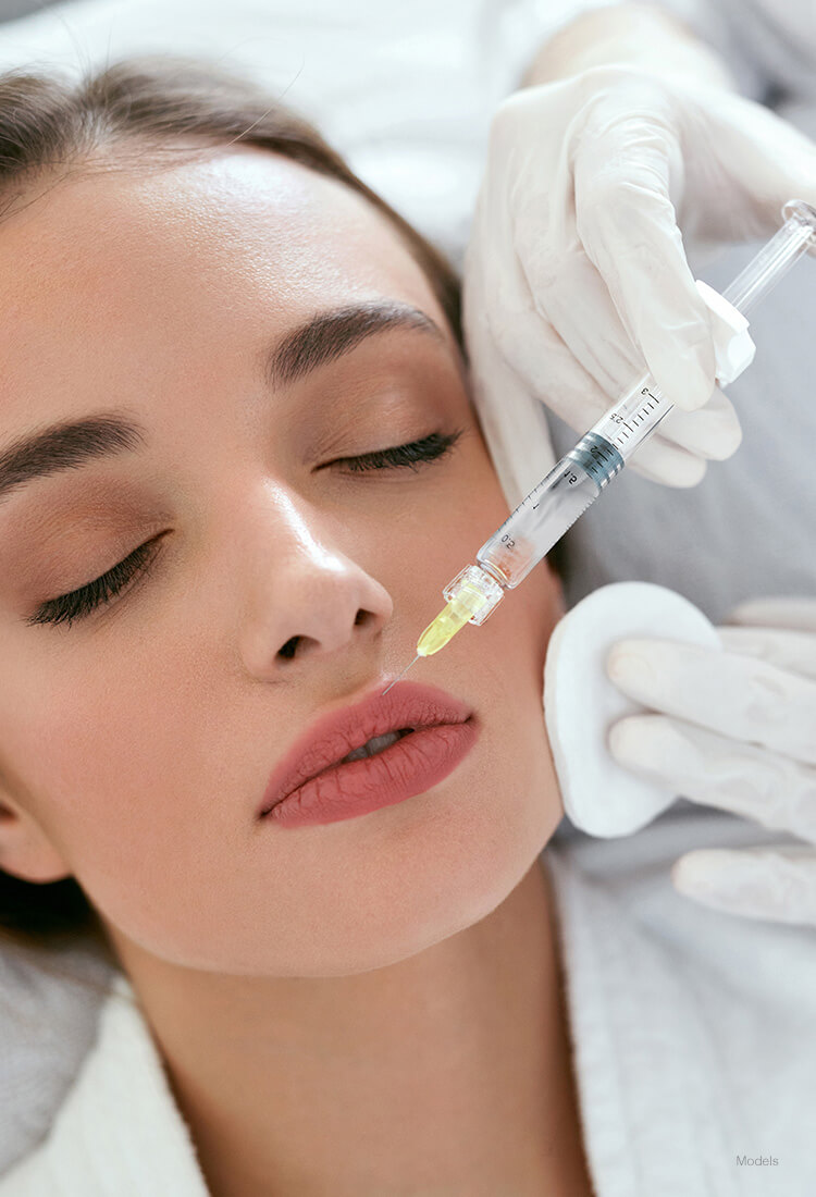 Woman getting injection on her lips