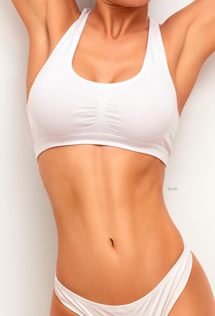 Woman in white sports bra