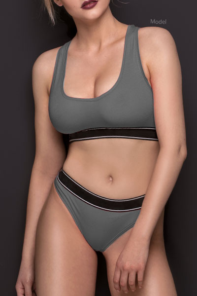 Woman in gray workout clothes