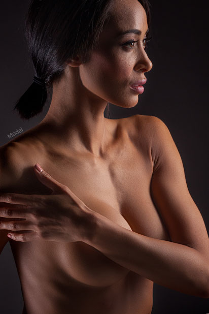 Woman with arm covering her breast
